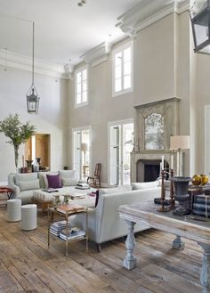 Love the ceiling heights and the all white decor...even the floors.