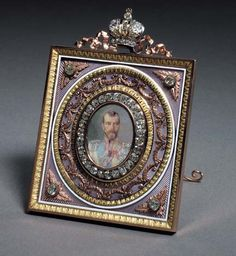A highly important jewelled three-color gold and guilloché enamel Imperial Presentation Frame marked Fabergé, workmaster Henrik Wigström, St. Petersburg, 1896-1908  diamond bezel enclosing a portrait miniature by Zuev depicting Tsar Nicholas II in the uniform of the Chevalier Garde Regiment, with scroll strut, marked on rim and strut, the miniature numbered 368 on reverse.