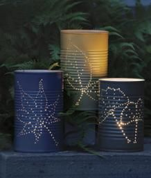 How to Make Garden Lanterns: Make your own candleholders from recycled tin cans. Add a folk-art touch to the garden and bonus - they are fun and easy to create. Most of the materials can be found in the recycling bin and in a reasonably well-stocked tool shed. The designs I use are often inspired by the plants and trees around my house, and they reflect the overall feeling of my garden. | Fine Gardening