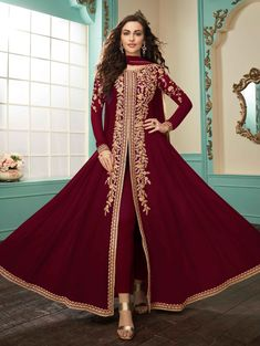 Deep Red Slit Style Embroidered Anarkali Suit is indian wear designed for festival or wedding parties. This outfit features ethnic embroidery work with zari, thread and stone detail on georgette an. Anarkali Tops, Anarkali Suits, Abaya Fashion, Ethnic Fashion, Indian Salwar Kameez, Mauve Dress, Designer Anarkali, Silk Pants, Ahmedabad