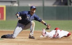 Tampa Bay Rays shortstop Ben Zobrist, left, tags out Chicago White Sox' Dewayne Wise during the first inning of a baseball game in Chicago, Sunday, Sept. 30, 2012.