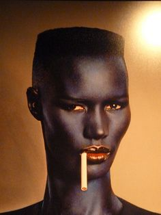i would love to have a model(s) with this mini flat top style hair. or anything with those harsh angels   Grace Jones by Jean Paul Goude