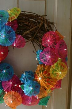 Get the party started with this festive wreath made from cocktail umbrellas! Free tutorial with pictures on how to make a recycled wreath in 2 steps by decorating and papercrafting with wreath form and cocktail umbrellas. Summer Crafts, Diy And Crafts, Party Crafts, Umbrella Wreath, Mini Umbrella, Beach Umbrella, Cocktail Umbrellas, Paper Umbrellas, Paper Lanterns