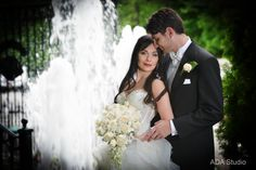 sweet bride and groom. great water fountain shot behind them.