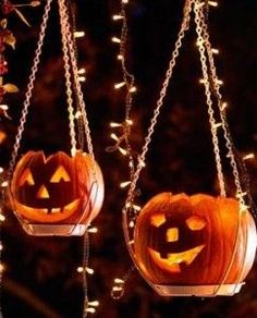Cheerful pumpkins hung from plant hangers and string lights
