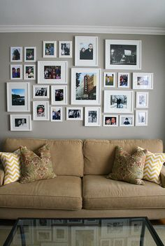 neutral wall, white frames. We love this idea for an accent wall! In the hallway, living room... anywhere!!