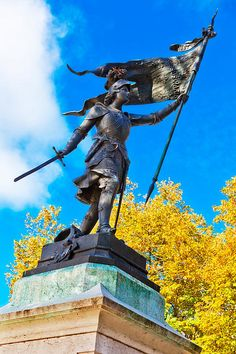 At Veda's grave stand a tall statue of Joan of Arc, a warrior woman of old whose story has been told ages after her death. She is never forgotten. Joan D Arc, Saint Joan Of Arc, St Joan, Female Armor, Female Knight, Catholic Saints, Patron Saints, Joan Of Arc Statue, Jeanne D'arc