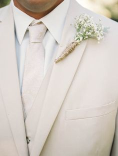 cream groom attire with babys breath boutonniere #groom #cream #babysbreath http://www.weddingchicks.com/2014/01/21/vintage-southern-wedding/