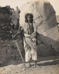 A Beja Warrior, this photo was taken in 1921, but the dress of these tribesmen had not changed since their fathers and grandfathers fought the British under the banners of the Madhi.