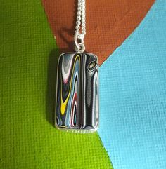 Fordite and Sterling Silver Pendant by jamesblanchard on Etsy, $165.00