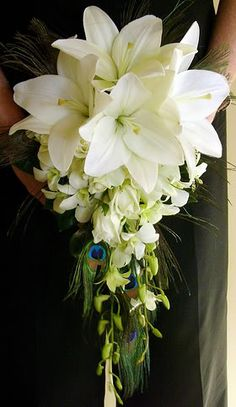 White lily and orchid cascade bouquet with peacock feathers
