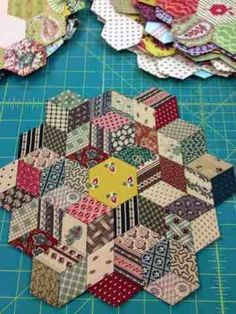 Looks like tumbling block pattern using hex English paper piecing ...cjh