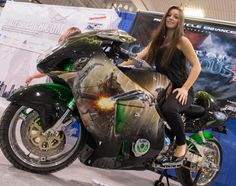 Chloe Conover and the Resident Evil Contagious Hayabusa as seen at the Toronto Motorcycle and Tattoo Show April 13-14, 2013.