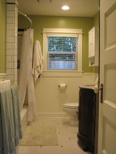 Small Bathroom Ideas / design bookmark #9416 Similar layout to my bathroom. Have a medicine cabinet where window is, but can see how the two colors cuts up the room visually. Towels add clutter, but where would you put wet towels?