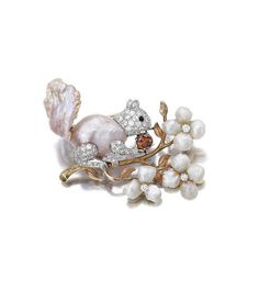 A cultured freshwater pearl, diamond and colored diamond brooch, Ruser.