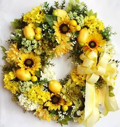 """Thanks so much for stopping by and visit my creations.     This beautiful Spring/Summer/Tuscan flower door wreath sets on a grapevine wreath base.  The wreath is embellished with Sun Flowers, yellow/light green Hydrangea, olive green and yellow Chrysanthemum, and white Baby Breath. The wreath is accented with five lemons and three cluster of small Lemon. I finished the wreath with a yellow/yellow checkered ribbon bow.   The wreath measures from tip to tip at 26"""" (L) x 26"""" (W) x 7.5""""(D)."""
