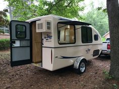 """Lil' Snoozy"" Small Travel Trailer—Dimensions : Over All: Length 18 ft. 6 in. (encompasses tongue to rear of AC unit),  Height 7 ft. 7 in., Width 8 ft. (from outside tire to outside tire)   Starting at $19,995.00"