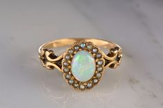 Victorian Rose Gold Cabochon Cut Precious White Opal Engagement Ring with Platinum - Toned Seed Pearl Halo