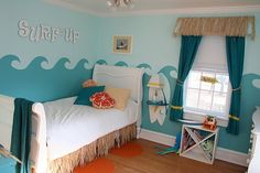 Surf theme kids room. I like the paddle board nightstand... clever!