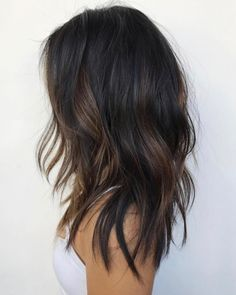 Beautiful dark cool and warm balayage— dark, cool-toned root fading into lighter warm-toned mids and ends. A beautiful look for anyone who still wants to maintain their dark locks in the fall and winter months without sacrificing any dimension.