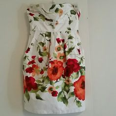*HOST PICK* *REDUCED* Alyn Paige floral dress **HOST PICK** *REDUCED* White, Alyn Paige, floral strapless zip up dress with one pocket on the front of each side, size 5/6. Red bow tie. One small flaw (pic 3), doesn't effect wear of the dress. Alyn Paige Dresses Strapless