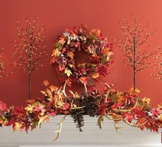 RAZ Autumn Mantel Display using a leaf garland, wreath, lighted twig trees and the new 2013 Antler Spray. The Antler Spray will be the only item from this display that we will have in stock.