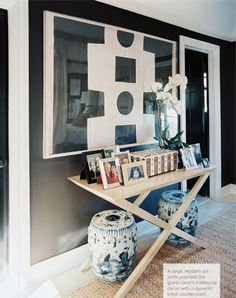 black and white art... blue and white garden stools.... mark sikes x table vignette