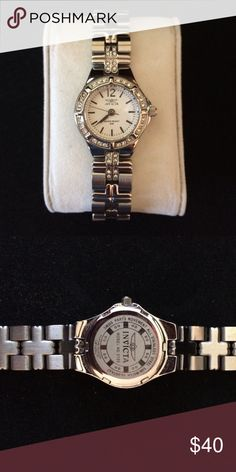 Women's Invicta Watch Invicta womens wildflower crystal accented watch. New without box. Model 0126 Swiss parts All stainless steel 50 M water resistant Flame fusion crystal  Needs a new battery   Smoke free/pet free home   Retails for $89 Invicta Accessories Watches