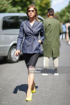 Carine Roitfeld wears sunglasses, a blazer jacket, a tweed skirt, and yellow shoes, outside the Dior show, during Paris Fashion Week - Menswear Spring/Summer 2018, on June 24, 2017 in Paris, France.