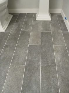 570198002794443363 master love the tiles. wall color: Benjamin Moore Gray Owl. Crossville Ceramic Co 6 x 24 planks (color: Lead) Grout (warm gray)