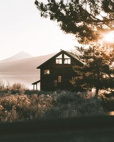 """lakeside cabin with a view of a mountain. i wanna move to a place like this. who's with me?"""