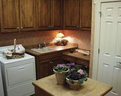 Pleasant Laundry Room | plan 024D-0062 | houseplansandmore.com #laundry #Home
