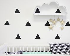 A cloud shelf from @urbanoutfitters + metallic star ornaments from @landofnod = a pretty darn cute DIY cloud shelf mobile. #nursery