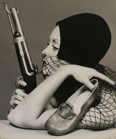 Sandi Mitchell with Moya shoe and flintlock pistol, Melbourne, Victoria, Australia, 1970.Photography by Bruno Benini