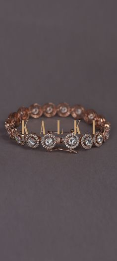 Buy Online from the link below. We ship worldwide (Free Shipping over US$100)  Click Anywhere to Tag Rose-Gold-Plated-Bracelet-With-Stones-In-Concentric-Round-Design-In-Chain-Pattern-Online-Kalki-Fashion Round Design, Gold Plated Bracelets, Indian Outfits, Rose Gold Plates, Stones, Free Shipping, Chain, Wedding Dresses, Link