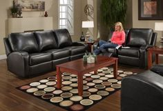 black leather couches... possibly in the living room
