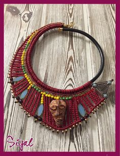 A personal favorite from my Etsy shop https://www.etsy.com/il-en/listing/267055152/micro-macrame-tribal-african-necklace