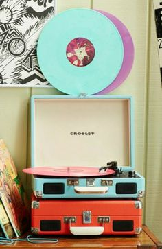Record player - had a little record player in a suitcase,  My parents had the big console like a piece of furniture.
