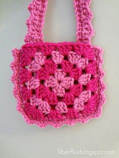 Fiber Flux...Adventures in Stitching: Free Crochet Pattern...Little Pink Purse    The Little Pink Purse is a perfect accessory for any girl who loves pink and allows little ones to tote all of their treasures around.  Big girls love it too!  Purse is quickly and easily made by sandwiching two granny squares together and finished off with a fun and frilly edge with a matching strap.  A liner can be added later if desired.