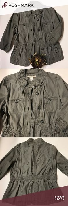 LOFT gray cotton jacket LOFT gray button up jacket with rounded collar, 4 pockets and drawstring to cinch. Cute as can be! 💯% cotton. There's a lighter spot on right back shoulder and on back of jacket which is barely noticeable. See last pic. LOFT Jackets & Coats