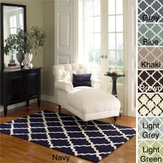Whether you get it in navy, blue, gray, or light green, this hand-hooked wool rug will blend with, and enhance, your decor. Its contemporary pattern and shape makes it perfect in a living room, and because it's made from wool it feels soft underfoot.