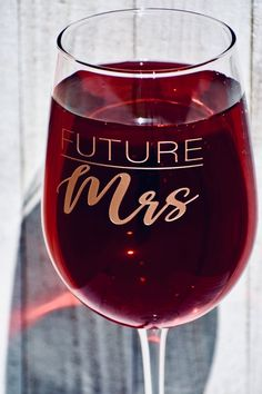 """Cheers to the Future Mrs.! Enjoy your Favorite wine with our Personalized Etched Stemmed Wine Glass. Awesome time to sit back and sip while you embark on new adventures together. Proudly Designed at our studio in Sunny Southern California!1: Simply select the quantity of glasses.2: Choose one of our designs3: Upon checkout (in the notes section), Each glass can be personalized with a name, title, initials, date, etc...Item Details:Stemmed Wine Glass (1)Height: 9.5""""Width: 3.5""""Glass Volume…"""