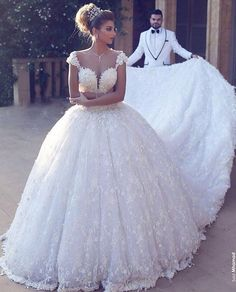This haute couture wedding dress is costly. But our dress design firm can make a very close #replica of this designer wedding gown that will look very similar but will cost much less. Contact us for info on custom wedding dresses & replicas you can afford on our website at www.dariuscordell.com