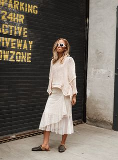 Lisa Olsson wears ZARA skirt, Free People top and Gucci shoes