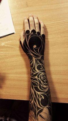Wind and Roses Blackwork tattoo on Arm