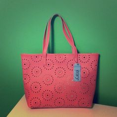 ENVY perforated tote in pink. NWT EVNY perforated tote in pink with inside zipper pouch. NWT! Envy Bags Totes