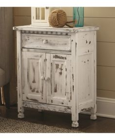The charming cottage design and antique finish of the Country Cottage Accent Cabinet from Alaterre make it a wonderful addition to any home. Features reclaimed wood construction, square legs, panel doors with knob handles, and a scalloped base. Country Cottage, Decor, Bathroom Cabinets Diy, Accent Cabinet, Cabinet, Country Cottage Decor, Furniture, Accent Doors, Alaterre Furniture