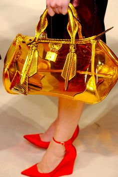 Burberry clear bag.  Shoes aren't too shabby, either!