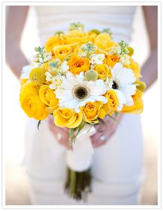 Yellow and white bouquet of roses and daisies