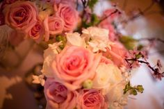 Close up of the rose, hydrangea, and cherry blossom centerpieces